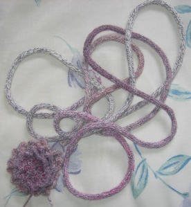 lots of i-cord and a knitted flower